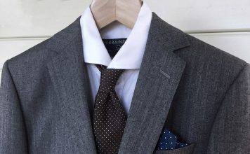 Understated medium gray wool suit with a white shirt, restrained tie and pocket square - an excellent choice for cocktail wear.